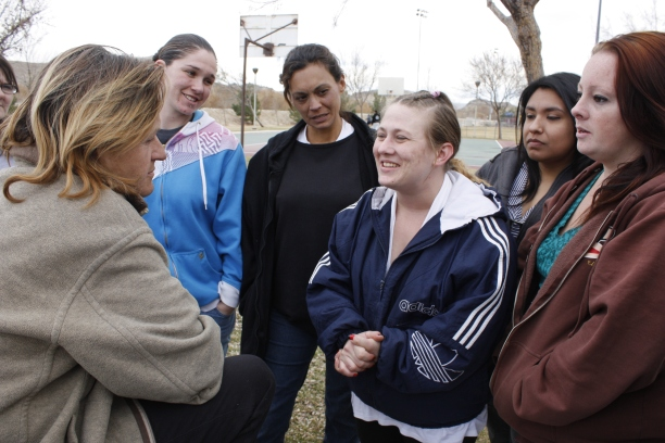KAT MINER, SPECIAL TO THE DAILY PRESS Heather Howard (center, facing camera) shares her story of how living at the Set Free Home for Women has made a positive difference in her life. The women were on hand with along with others from Awakening Ranch Rescue Mission to minister and distribute food to those in need at Eva Dell Park in Victorville on Saturday. Awakening Ranch is based in El Mirage.