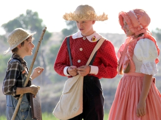 """KAT MINER, SPECIAL TO THE DAILY PRESS This year's """"look-alike"""" winners from the Huck Finn Jubilee, 10 year old Nathaniel Maggs of Riverside (left), 14 year old Logan Locke of Hannibal, Missouri (center) and best friend Jessica Taylor also 14 and also of Hannibal, Missouri (right). The Huck Finn """"look-alike"""" contest is part of the annual Huck Finn Jubilee that takes place over Father's Day weekend at Mojave Narrows Regional Park in Victorville. The event continues today."""