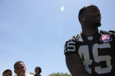 KAT MINER, FOR THE DAILY PRESS The Raiders' Marcel Reece at his football camp Saturday at Hesperia High.