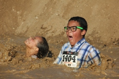 KAT MINER, FOR THE DAILY PRESS Participants getting down and dirty at the Maverick's Mud Run held Saturday at Stater Brothers Stadium in Adelanto. The event featured music, obstacles and lots of mud. Proceeds from the event will benefit the Veteran's Home of California-Barstow, Sultana High School Avid Program and High Desert Youth Center.