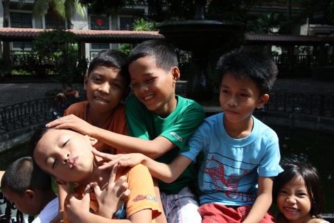 Manila school kids. Note hand gestures of the boy in orange... typical